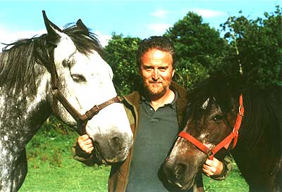 a horse-logger with his heavy horses